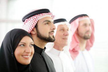 Successful and happy business arabic looking up