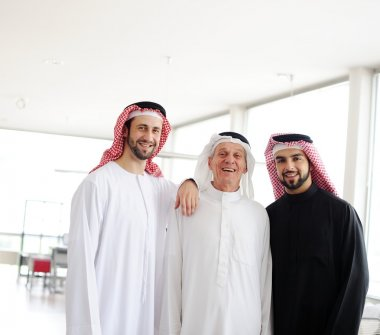 Successful and happy business arabic standing for a meeting