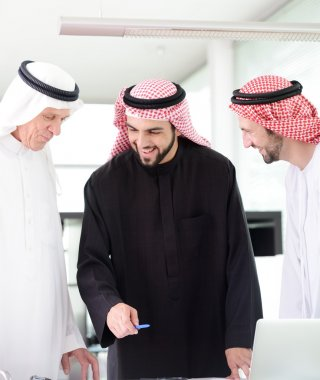 Successful and happy business arabic