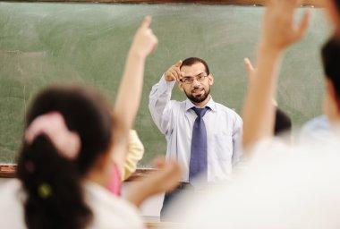 Arabic kids in the school, classroom wit a teacher