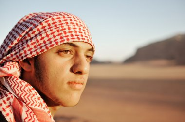 A resting bedouin deep in thought