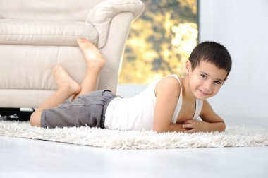 Happy child on floor in living room at home