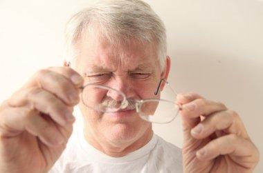 Senior man with dirty glasses