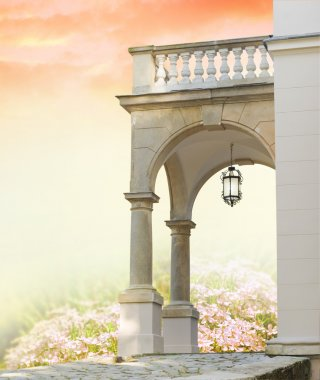 Classical portal with columns and garden