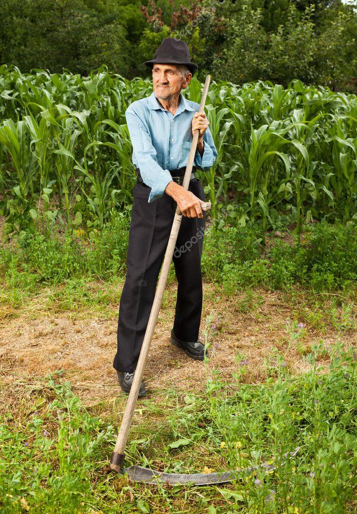 Senior farmer with scythe