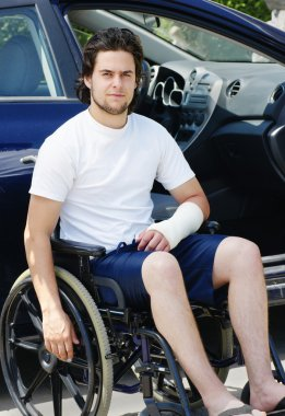 Young man with broken arm in hospital lot