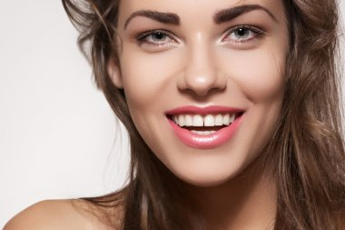 Happy beautiful young woman model with natural daily makeup. Lovely female smile with healthy white teeth