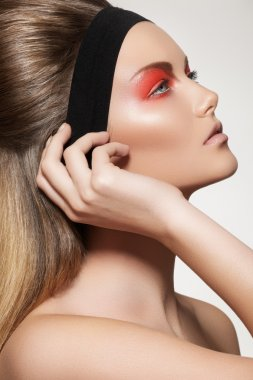 Health, beauty, wellness, haircare, cosmetics and make-up. Beautiful retro hairstyle. Woman model with shiny straight long hair and fashion make-up