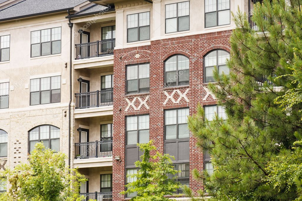 A modern brick and stucco apartment building by pine trees   Photo by  dbviragoModern Brick and Stucco Apartments by Trees   Stock Photo  . Modern Brick Apartment Building. Home Design Ideas