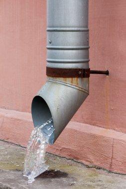 Frozen water in the gutter