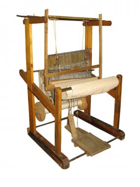 Ancient wooden loom isolated