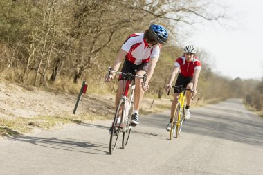 Athletes Riding Cycles