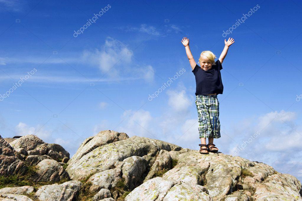 Boy reaching top