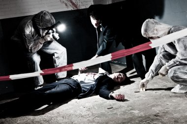 A cross processed murder scene with two forensic analysts and a police lieutenant investigating a crime on a businessman in a basementMurder scene with two forensic analysts and a police lieutenant investigating a crime on a businessman in a basement stock vector