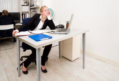 Woman, working in an office, staring blankly at a blind wall out of boredom stock vector