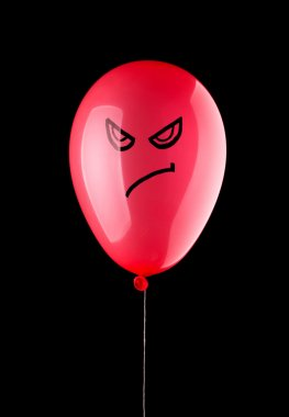 Angry red balloon isolated on black stock vector