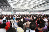 The crowd inside the airport or station