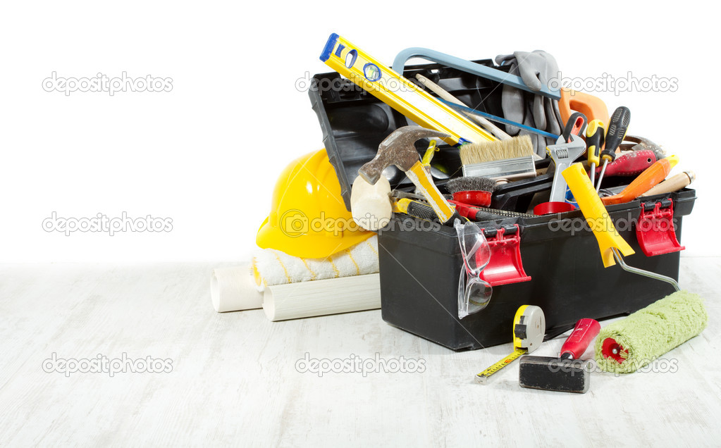 Tools in toolbox over wooden floor against empty wall. Copy spac