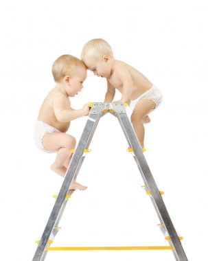 Two babies climbing on stepladder and fighting for first place