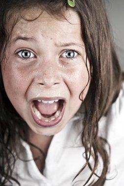 Child Screaming at Camera