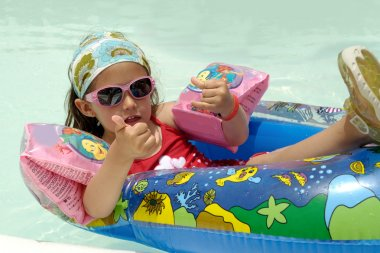 Child in pool relaxing