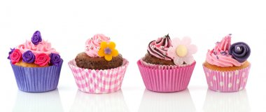 Row colorful cupcakes