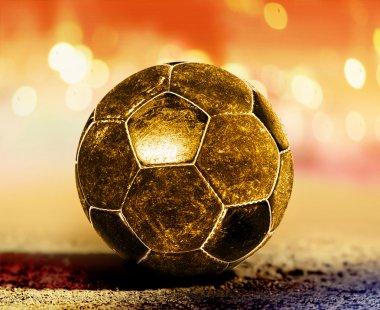 Golden ball on ground