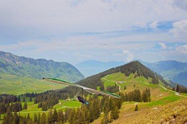 Hang gliding in Swiss Alps, Switzerland, Europe