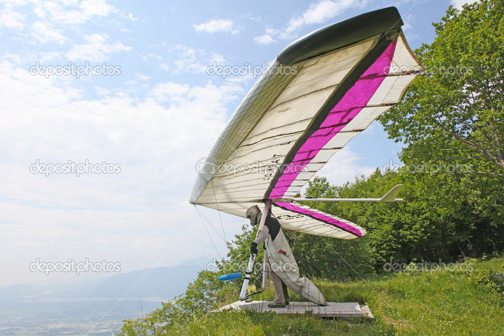 GEMONA, ITALY- JULY 2012: Julia Burlachenko competes in the Italian Open-2012 hang gliding competitions at Gemona on July 17, 2012 near Gemona, Italy