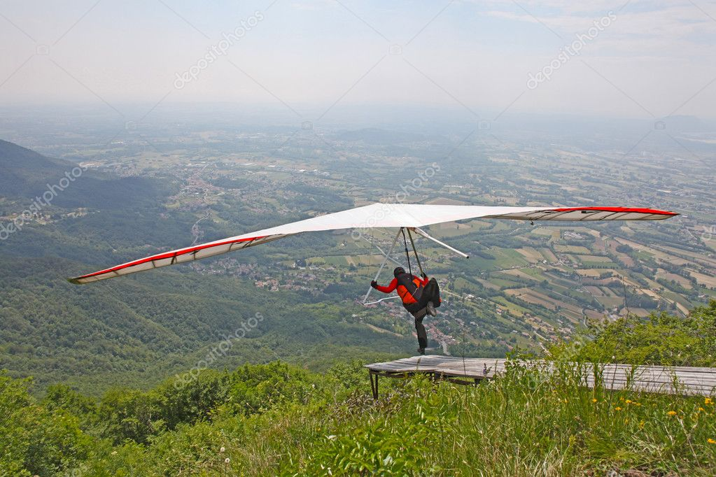 GEMONA, ITALY- JULY 2012: Artem Chervonenko competes in the Italian Open-2012 hang gliding competitions at Gemona on July 17, 2012 near Gemona, Italy