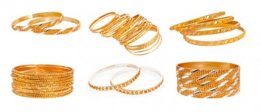 Set of the Gold Bracelet placed on white