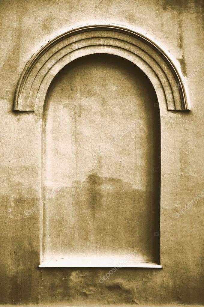 Old aged plastered faux arch false fake window stucco frame ...