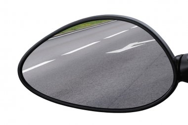 Rear view mirror reflecting road, left side lateral, macro closeup