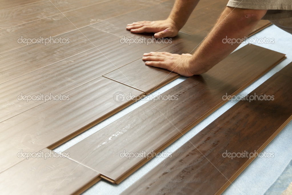 Man Installing New Laminate Wood Flooring
