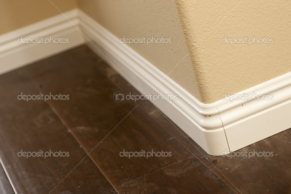 New Baseboard And Bull Nose Corners With Laminate Flooring Stock Photo 11301378