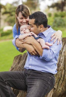 Happy Mixed Race Family with a Baby Boy Enjoying The Park