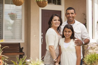 Small Hispanic Family in Front of Their Home