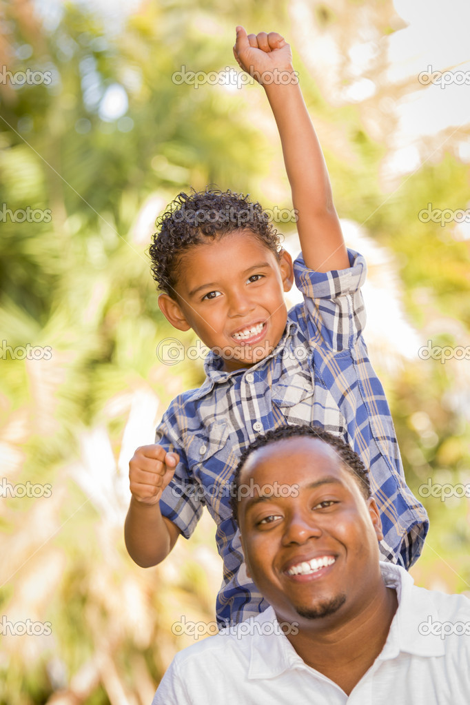 Happy Mixed Race Father and Son Cheering with Fist in the Air at the Park. stock vector