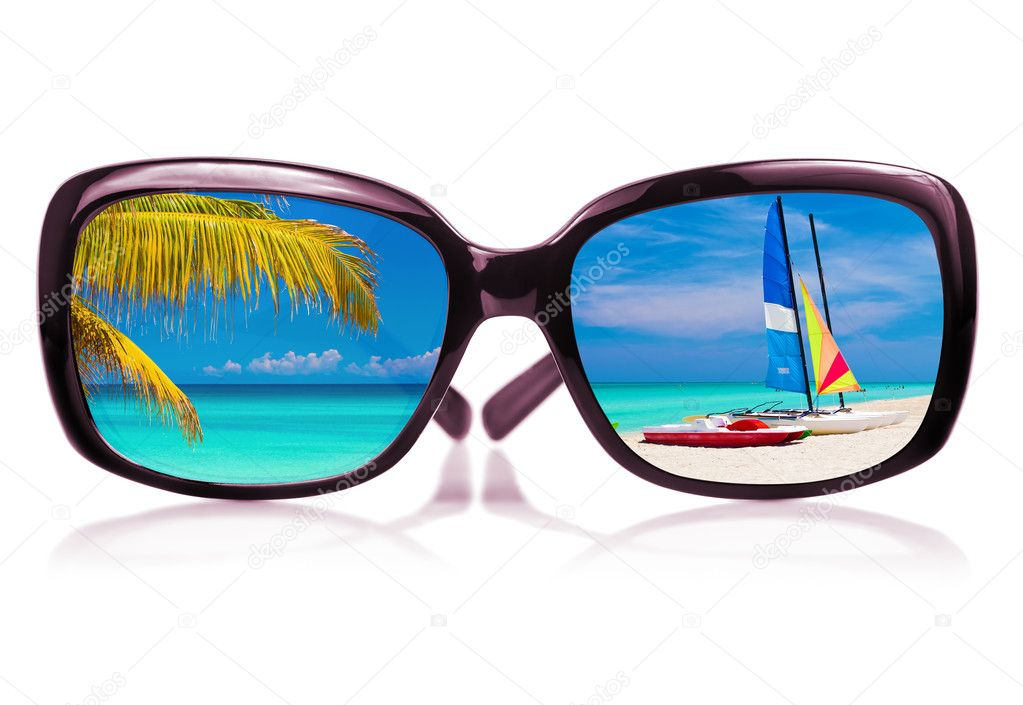 Sunglasses with beach scenes reflected on the glass