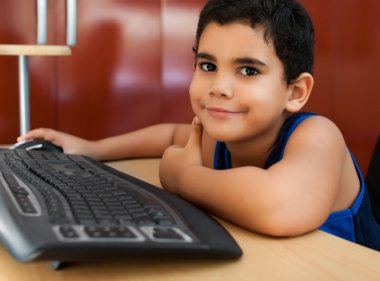 Hispanic child working with a computer