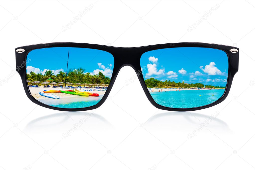 Sunglasses with reflections of a tropical beach