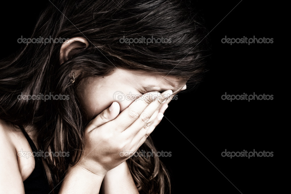 Portrait of a girl crying and hiding her face — Stock Photo