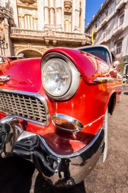 Shiny vintage Chevrolet in front of The Great Theater of Havana
