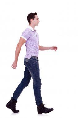 Side view of a fashion man walking forward