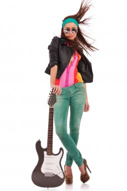 Hot rock and roll woman with electric guitar