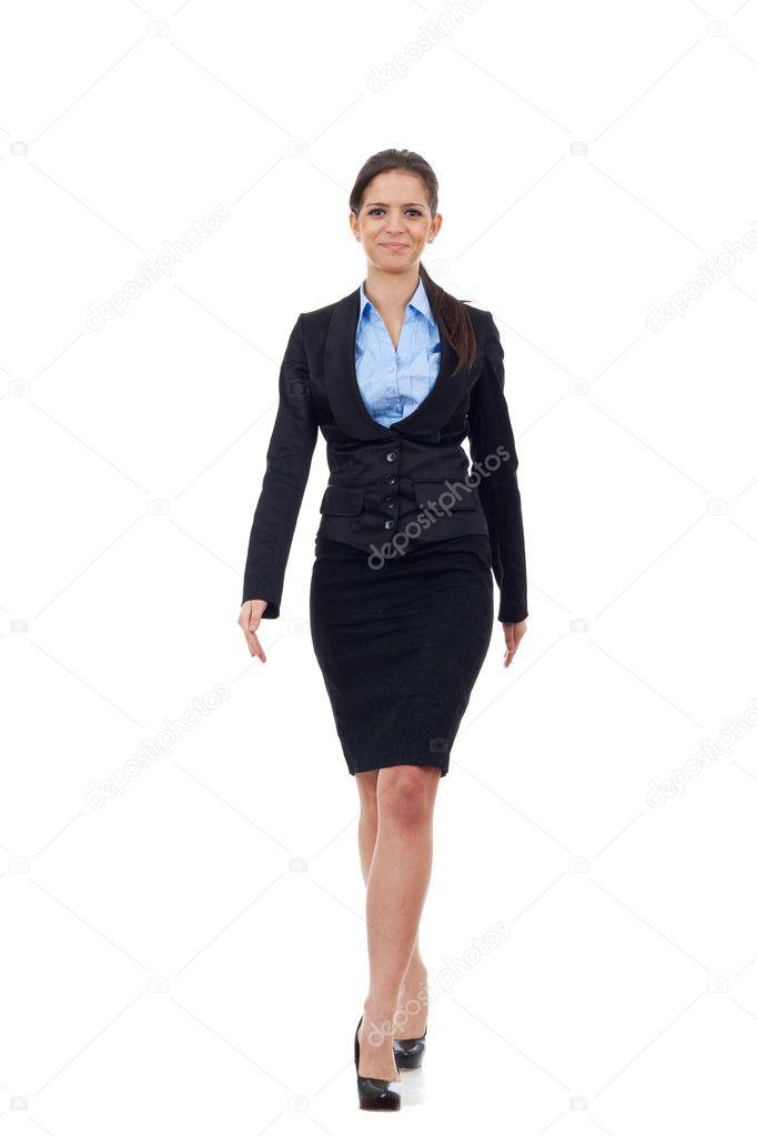 Young business woman walking towards camera — Stock Photo ...