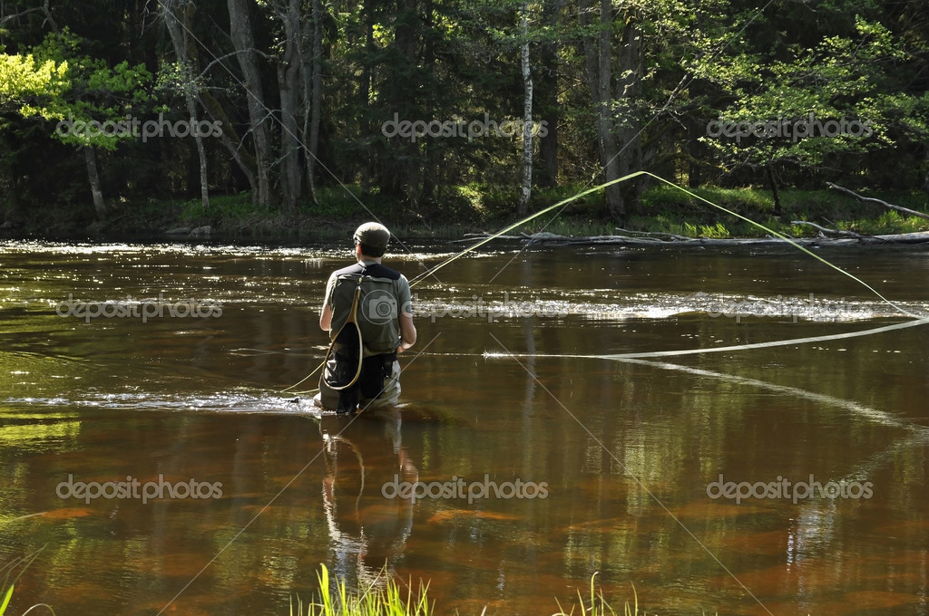 Fisherman in a river