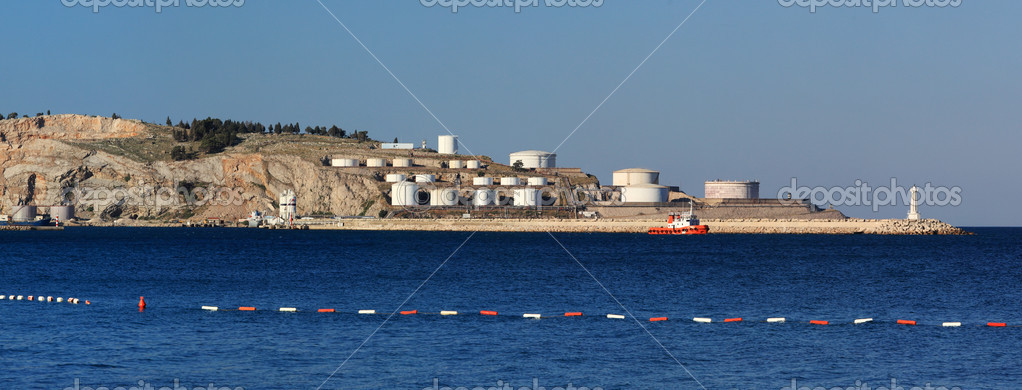 Sea with oil tanks