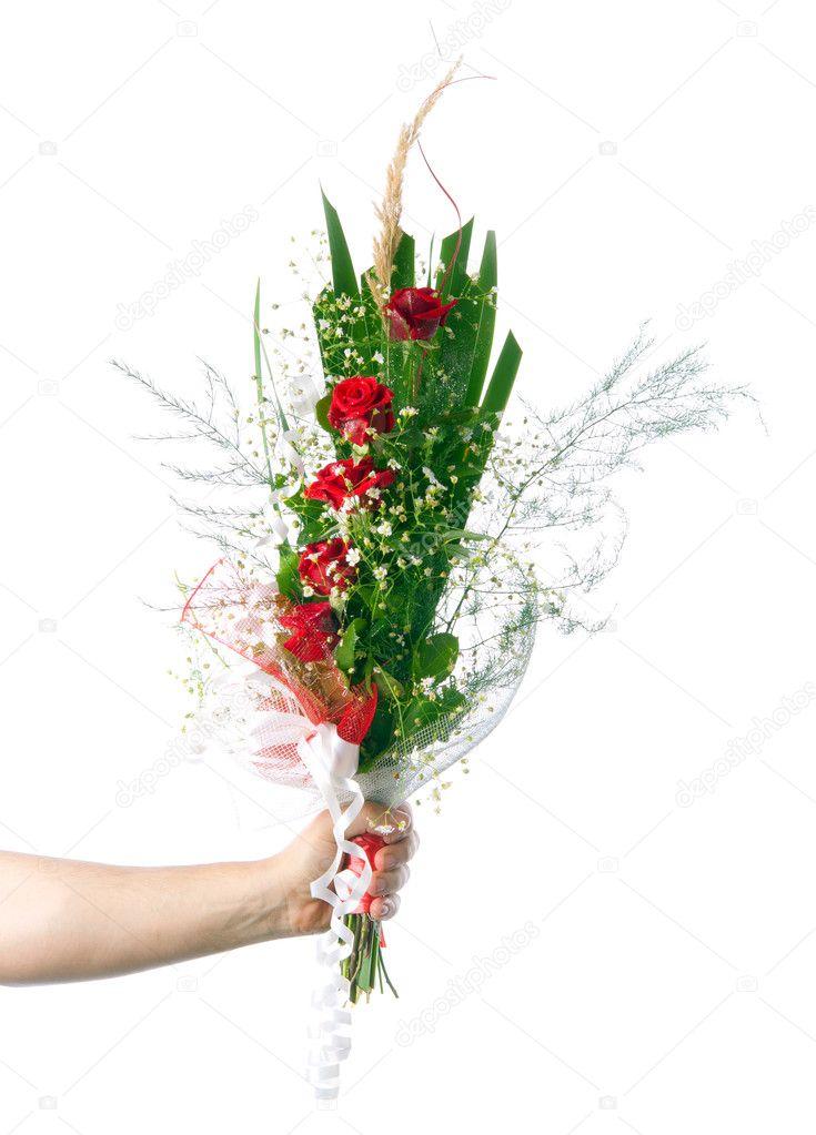 männliche Hand mit schönen Blumenstrauß aus Rosen und kleine weiße ...
