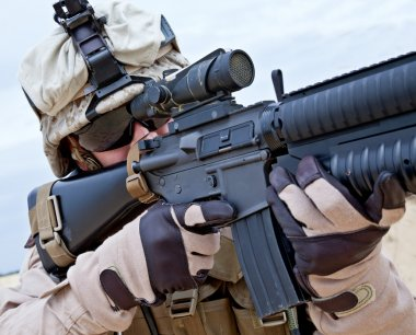 Close-up shot of US marine shooting his rifle stock vector
